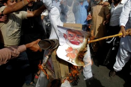 Pakistani protesters burn a poster of Indian Prime Minister Narendra Modi during a protest in Lahore, Pakistan, Thursday, June 11, 2015. Pakistan has reacted angrily to comments made by the Indian prime minister that reportedly acknowledged Indian forces had a role in the war that created Bangladesh, part of Pakistan until 1971 when separatists won independence after a war. (AP Photo)