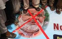 Pakistani protesters stand on a banner of Indian Prime Minister Narendra Modi during an anti-Indian protest in Multan, Pakistan, Thursday, June 11, 2015. Pakistan has reacted angrily to comments made by the Indian prime minister that reportedly acknowledged Indian forces had a role in the war that created Bangladesh, part of Pakistan until 1971 when separatists won independence after a war. (AP Photo)
